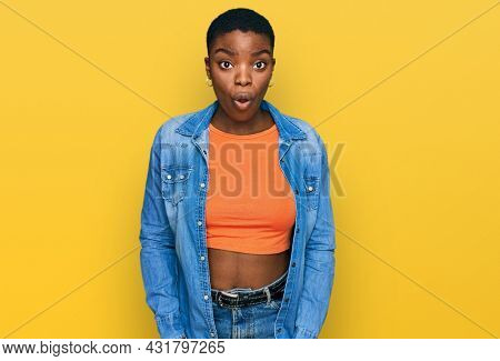 Young african american woman wearing casual clothes afraid and shocked with surprise and amazed expression, fear and excited face.