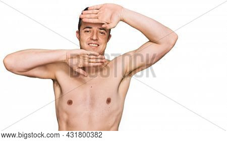Handsome young man wearing swimwear shirtless smiling cheerful playing peek a boo with hands showing face. surprised and exited