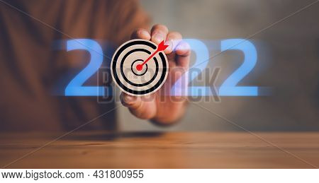 New Year 2022 And Goal Or Target Icon. Concept Of New Year Business Goals And Vision. Businessman Cl