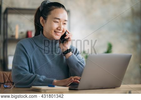 Young Business Woman Working On Laptop In Home Office, Work From Home Concept. Asian Female, Online