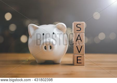 Save From Wood Cubes And Piggy Bank. Money Savings, Save And Investment Concept.