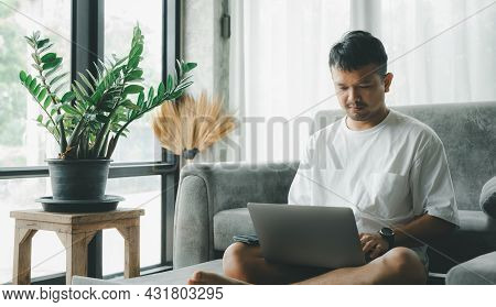 Asian Businessman Smile And Work From Home With Laptop Computer, Online On Sofa In Living Room, Free