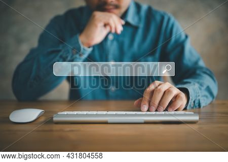 Data Search Technology Search Engine Optimization. Man's Hands Are Using A Computer Keyboard To Sear