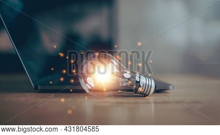 Light Bulb With Laptop Computer, Idea Of inspiration From Online Technology, Innovation Idea Conce