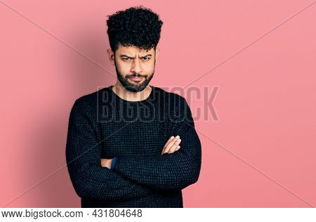 Young arab man with beard with arms crossed gesture skeptic and nervous, frowning upset because of problem. negative person.