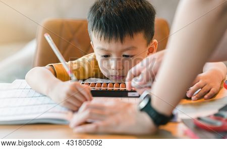 Asian Boy Learning Math With An Abacus, Education Concept, Home School, Social Distancing, Stay Home