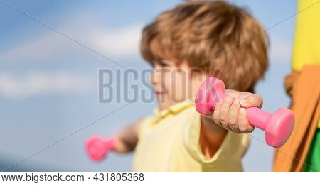 Healthy Lifestyle. Fitness Child. Kid Exercising With Dumbbells. Sport For Little Children. Sporty B