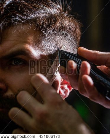 Barber Works With Hair Clipper. Hipster Client Getting Haircut. Hands Of Barber With Hair Clipper. H