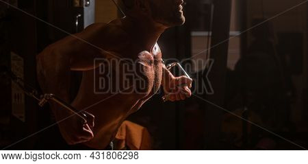 Fitness Man Execute Exercise With Exercise-machine Cable Crossover In Gym. Man With Big Muscles In G