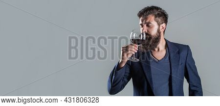 Man Holding Glass Of Champagne In Hand. Man With A Glass Of Red Wine In His Hands. Beard Man, Bearde