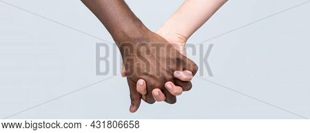 White Woman, African Man Holding Hand Friendship Symbol. African Peace Symbol. Mixed Race Couple Hol
