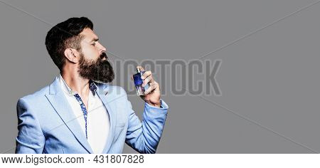 Masculine Perfume, Bearded Man In A Suit. Copy Space. Masculine Perfume, Bearded Man In A Suit. Perf