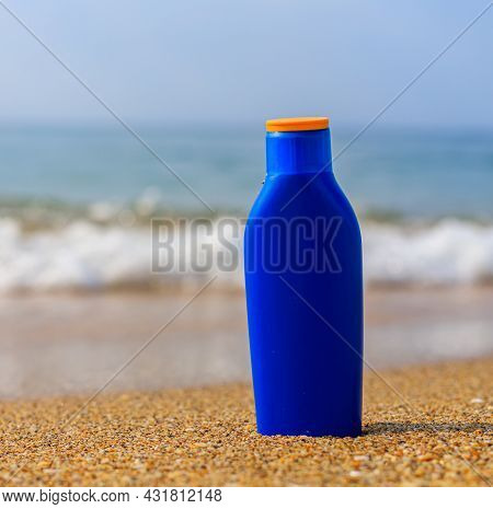 Sunburn Milk On The Background Of The Sea .protection Of The Skin From The Sun. Uniform Tan. Sfp . B