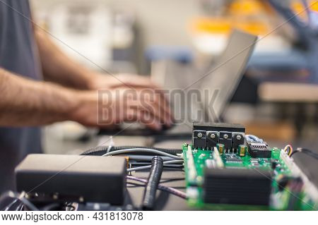 Engineer Technician Electrician Inspect System With Laptop Computer. Electric Installation