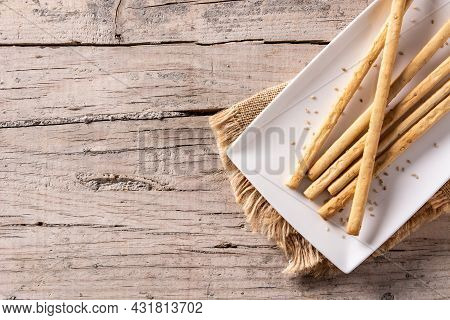 Breadstick Grissini Snack On Wooden Table. Top View. Copy Space