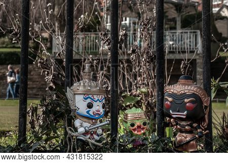Ravana, Giantess And Hanuman Standing On The Wall Of The Iron Fence In The Park. Traveller Doll.