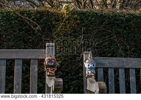 Ravana And Giantess And Hanuman Sitting On The Backrest Of The Wooden Chair At The Park. Traveller D