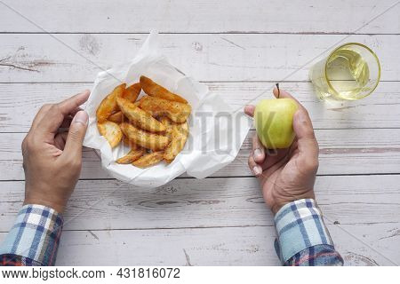 Comparing Apple And Potato Wedges, Eating Heathy Food Concept .