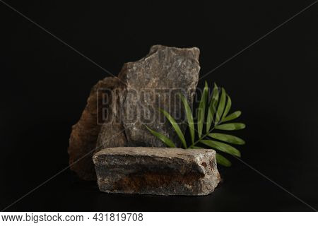 Rock Podium On The Black Background With Tropical Leaves. Stone Podest For Product, Cosmetic Present