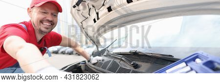Foreman Opening Hood Of Car And Taking Metal Tool From Suitcase