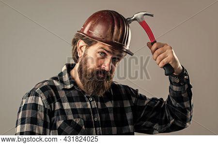 Brutal Man Builder In Uniform And Helmet With Hammer, Repair