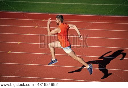 Energy Inside. Runner On Racetrack. Challenge And Competition. Marathon Speed. Sport Athlete Run Fas