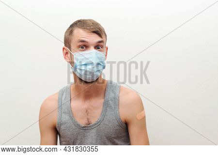 Happy Man Showing His Arm With Bandage After Receiving Vaccine. Vaccination, Immunization, Inoculati