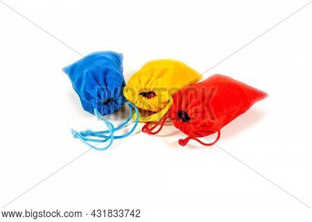 Three colorful pouch's with gems and stones isolated on white background