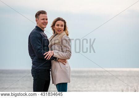 Outdoor Fall Portrait Of Fashionable Pretty Young Couple Wearing Trendy Spring Clothes. Two Lovers P