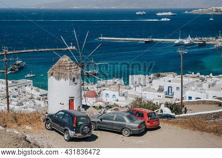 Mykonos Town, Greece - September 24, 2019: Cars Parked By A Windmill On A Hill In Hora (also Known A