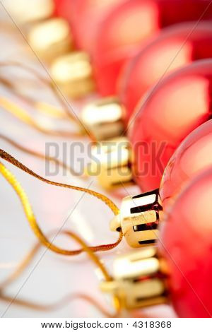 macro row of red christmas balls backgrounds poster