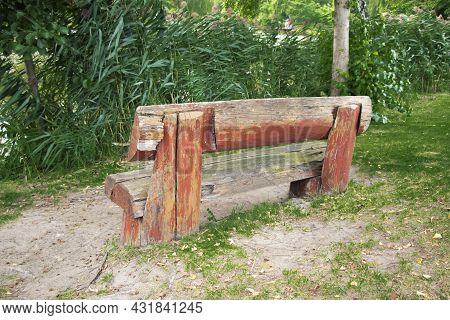 Old Park Bench. Rural Bench Rear View. Wooden Shabby Bench