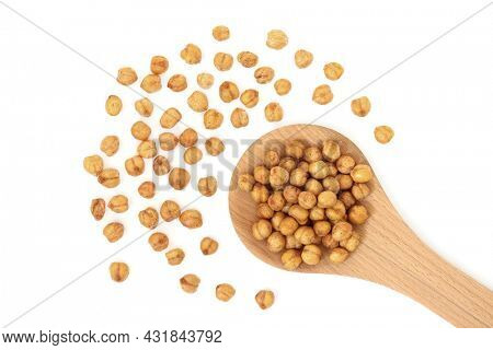 Vegan roasted spicy chickpeas in a wooden spoon. Healthy organic food high in fibre, vitamins, minerals, protein. On white background. Flat lay, top view.