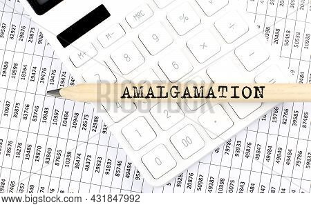 Text Amalgamation On The Wooden Pencil On Calculator With Chart