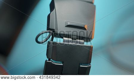 Close Up Of Male Hands Fastening Protective Belt. Action. Fastening Black Plastic Clamp Safety Belt,