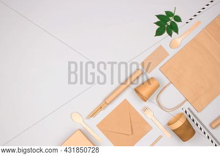 Flat Lay Composition With Eco-friendly Tableware - Kraft Paper Food Packaging On Light Gray Backgrou