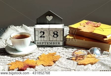 Calendar For September 28 : The Name Of The Month In English, Cubes With The Number 28, A Cup Of Tea