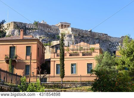 Acropolis Rises Over Houses In Plaka District, Athens, Greece, Europe. This Place Is Tourist Attract