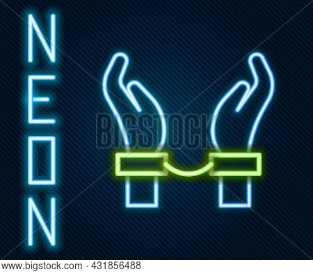 Glowing Neon Line Handcuffs On Hands Of Criminal Man Icon Isolated On Black Background. Arrested Man