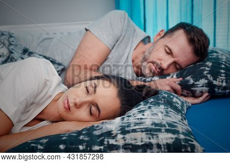 Young Couple Sleeping In Bed. Healthy Sleep Concept