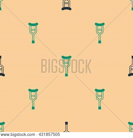 Green And Black Crutch Or Crutches Icon Isolated Seamless Pattern On Beige Background. Equipment For