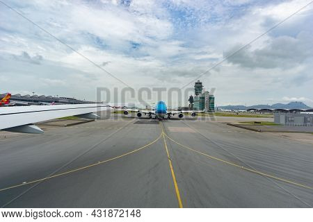 Chek Lap Kok Hong Kong - August 3 2017; Planes And Runway Markings Leading From Plane On Airport Run