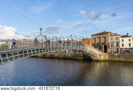 Dublin Ireland - August 16 2017; People Crossing On The Pedestrian Ha'penny Bridge Across Liffey Riv