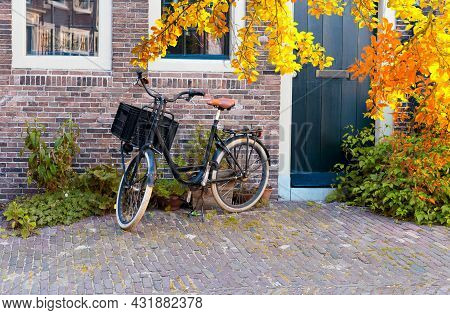 Small Pedestrian Paved Street With Bicycle, Leiden Historical Old Town, Netherlands At Fall