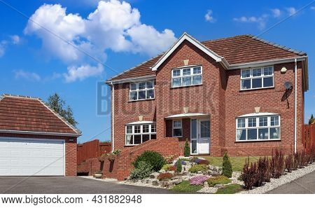 New detached house with garage and blue sky