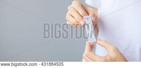 Man Holding Rapid Antigen Test Kit With Negative Result During Swab Covid-19 Testing. Coronavirus Se