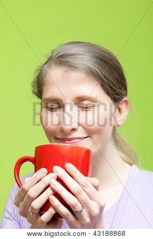 Woman Savouring A Mug Of Hot Coffee