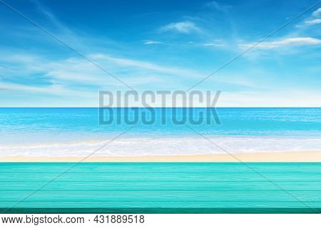 Summer Vacation Concept : Blue Wooden Table Top With Blurred Beautiful Seascape View Of Blue Sea And