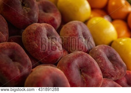 Juicy Nectarines On The Market Counter. Vitamins And Health From Nature. Side View. Close-up.