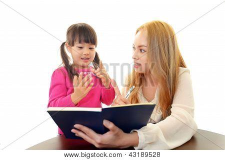 English teacher with girl studying.